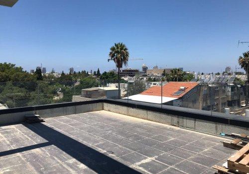 דירת גג נפלאה בלב העיר .